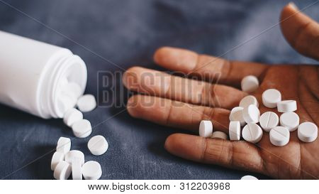 Medication In Hand, Committing Suicide By Overdosing On Medication, Health Care And Medical Concepts