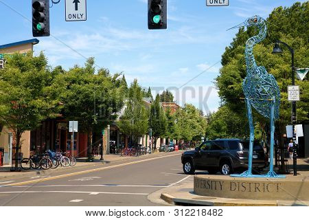 June 30, 2019 In Eugene, Or: Tree Lined Street With Boutique Shops And Restaurants Taken In Downtown