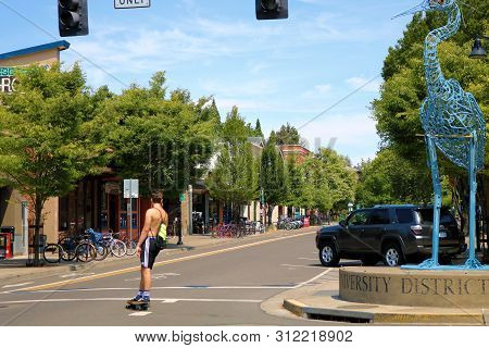 June 30, 2019 In Eugene, Or:  Man Skateboarding At The Quaint Downtown District With Boutique Stores