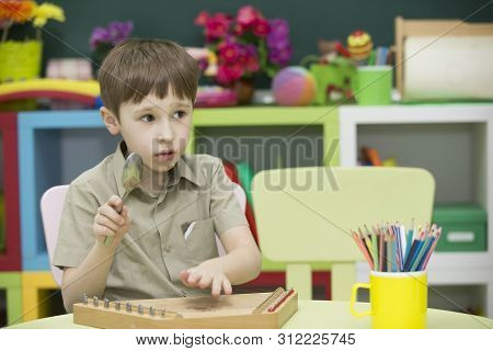 A Child With A Musical Instrument. Boy Learn To Play Dulcimer