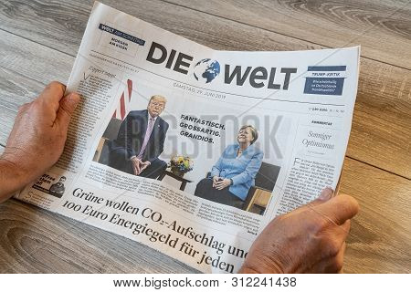 Frankfurt Am Main, Germany. June 29, 2019. The Lecture Of The Die Welt German Newspaper On A Wooden