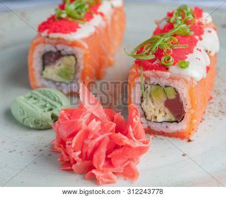 Shizu Fusion Roll. Wrapped In Salmon, With The Addition Of Mozzarella Cheese And Masago Caviar. Minc