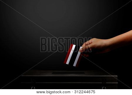 Hand Holding Card Thailand Flag For Election Vote.thailand Flag For Election Vote At Black Isolated