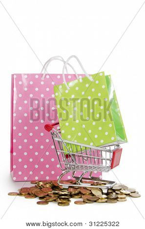 Shopping cart and bags isolated on white