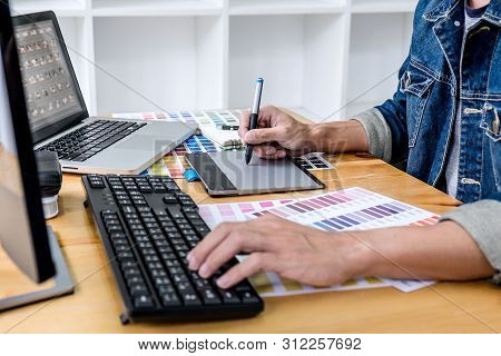 Image Of Male Creative Graphic Designer Working On Color Selection And Drawing On Graphics Tablet At