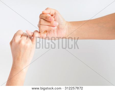 Two Hands Hook Pinky Fingers Together To Promise, Swear Or Asking For Reconciled Together.