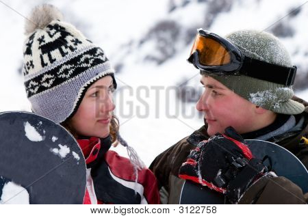 A Lifestyle Image Of Two Young Adult  Snowboarders (Series Sport, Extreme, Mountain, Horses And Teen