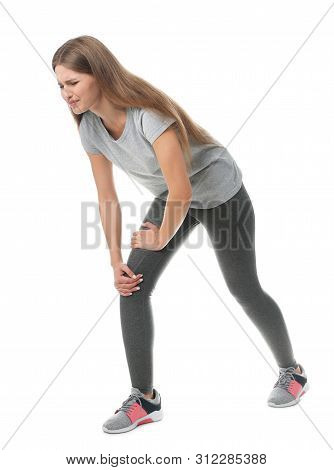 Full Length Portrait Of Sportswoman Having Knee Problems On White Background
