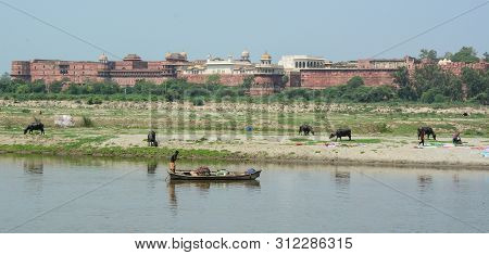 People Rowing Boat On Yamuna River In Agra, India. According To The 2011 Census, Agra District Has A