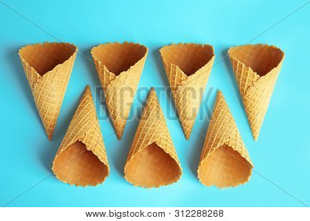 Empty Wafer Ice Cream Cones On Blue Background, Flat Lay