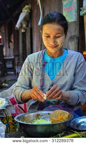 Nyaungshwe, Myanmar - Feb 6, 2017. A Vendor Selling Foods At The Local Market In Nyaungshwe, Myanmar