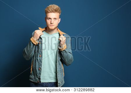 Young Man Wearing Blank T-shirt On Blue Background. Mockup For Design