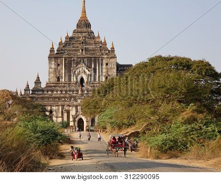Bagan, Myanmar - Feb 18, 2016. People Coming To The Thatbyinnyu Temple In Bagan, Myanmar. Thatbyinny