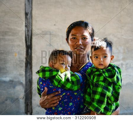 Nyaungshwe, Myanmar - Feb 6, 2017. Burmese Woman With Two Boys At Countryside In Inlay, Myanmar. Inl