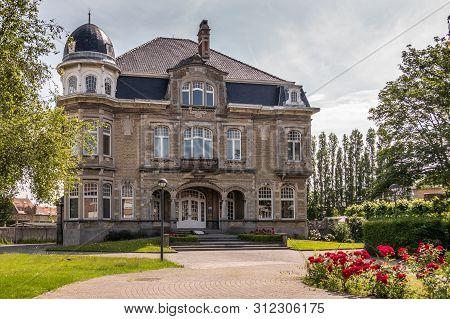Knokke-heist, Flanders, Belgium -  June 18, 2019: Kursaalstraat. Historic Brown-gray Building Of Pro