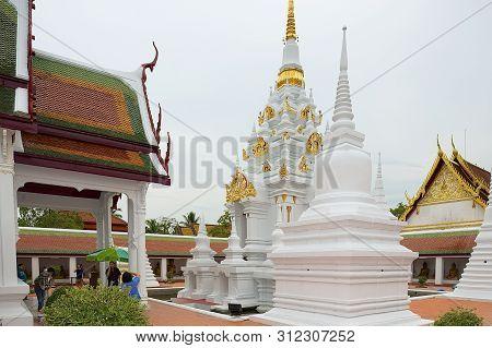 Surat Thani, Thailand - April 03, 2012: The White Pagoda For Remains Relics Of Buddha At Wat Phra Bo