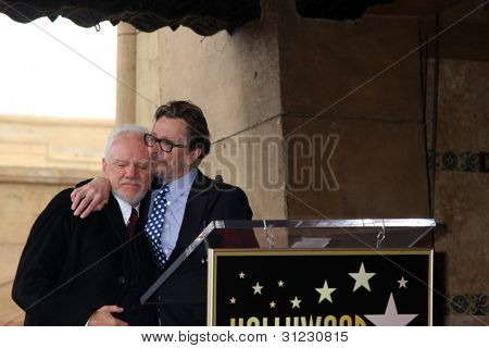 LOS ANGELES - MAR 16:  Malcolm McDowell, Gary Oldman at the Malcolm McDowell Walk of Fame Star Ceremony for The Muppets at the Hollywood Boulevard on March 16, 2012 in Los Angeles, CA