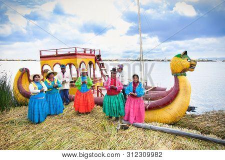 Uros, Peru- Jan 5, 2019: Inhabitants of Uros floating islands, Titicaca lake, Peru.