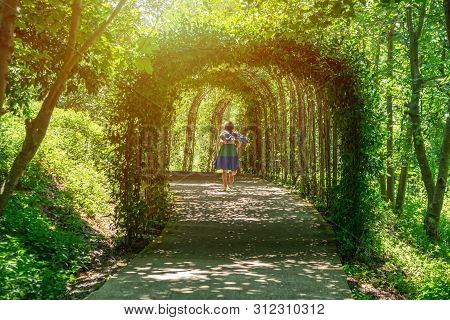 Beautiful Green Tunnel With Light In Background In Tvermaghala Park. Georgia.