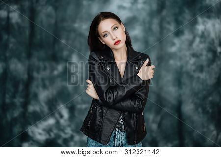 A portrait of a beautiful young woman. Beauty, cosmetics, evening makeup, women fashion.