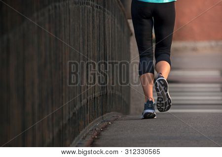 Ypung Woman Sprinting Outdoors, Sportive People Training In A Urban Area, Healthy Lifestyle And Spor