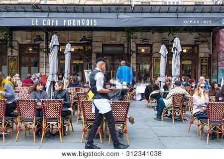 Bordeaux, France - May 5, 2019: A People Relax In Cafe Francais On Place Pey Berland In Bordeaux, Aq