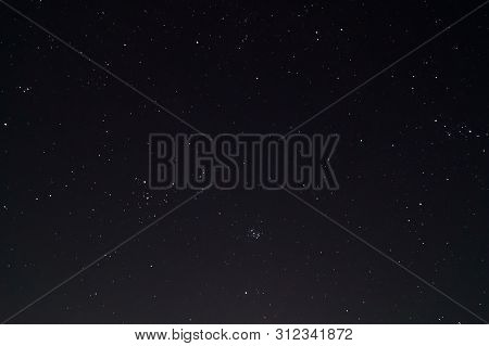 Underexposed Night Sky Low Light Photo. A Lot Of Stars And Constellations On Dark Sky. Stock Photo O
