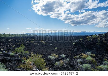 Lava Lands At Newberry National Volcanic Monument In Central Oregon. View Of The Cascade Mountain Ra