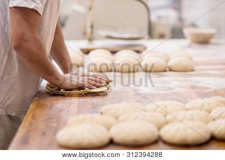 baker preparing the dough for products In a traditional bakery