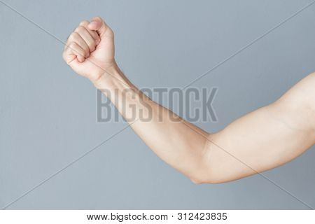 Back Arm Muscle Man With Grey Background, Health Care And Medical Concept