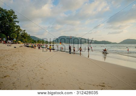 Phuket July 09, 2019 : The Unidentified People Are Relaxing On Patong Beach During A Sunny Day In Ph