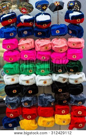 Moscow, Russia - 06/22/2019: Russian Colorful Souvenir Hats With Earflaps On Nikolskaya Street.