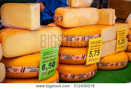 Dutch Cheeses Whole Round Wheels In A Cheese Store In Rotterdam, Netherlands