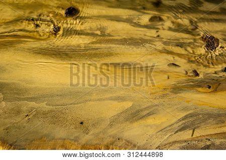 Detail Of Desert Life. Antuco Volcano Black Volcano Desert. Sulphurous Stream, Sulphur-containing Wa