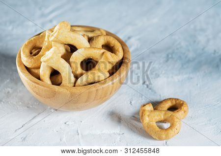 Taralli Is A Traditional Italian Snack Food Typical Of Puglia Regional Cuisine In Wooden Bowl. Ingre