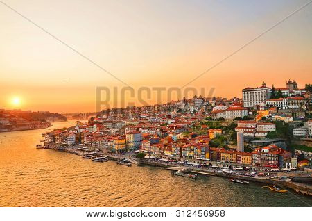 Magnificent Sunset Over The Porto City Center And The Douro River, Portugal. Dom Luis I Bridge Is A
