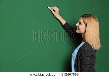 Beautiful Teacher Writing On Chalkboard, Space For Text