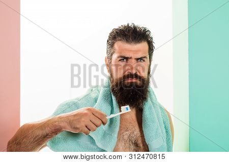 Serious Bearded Man Brushing Teeth. Oral Care. Tooth Brush. Tooth Paste. Cleaning Teeth. Morning Tre