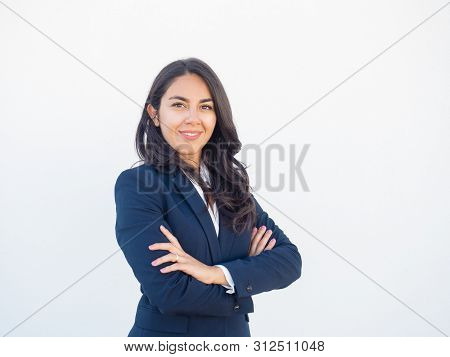 Happy Confident Female Business Leader Posing In Studio Background. Beautiful Young Latin Woman In F
