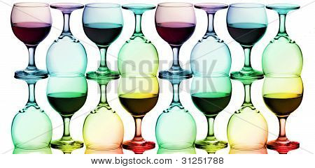 multicolored wine glasses on white background