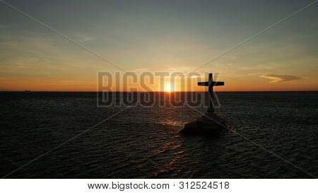 Catholic Cross In Sunken Cemetery In The Sea At Sunset, Aerial View. Colorful Bright Clouds During S