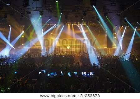 MOSCOW - MAY 7: Audience members dance during a colorful light show presented by disc-jockey Armin van Buren (Armin van Buuren) ARMIN ONLY: Mirage, May 7, 2011, Moscow, Russia. The event is at the State Central Concert Hall Russia.