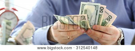 Male Arms Counting Big Amount Of Us Currency At Worktable Closeup