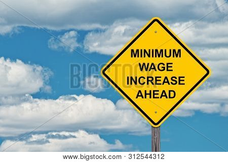 Minimum Wage Increase Ahead Caution Sign Blue Sky Background