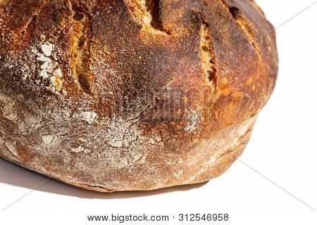 Close up of freshly baked artisan sourdough bread loaf isolated on white. poster