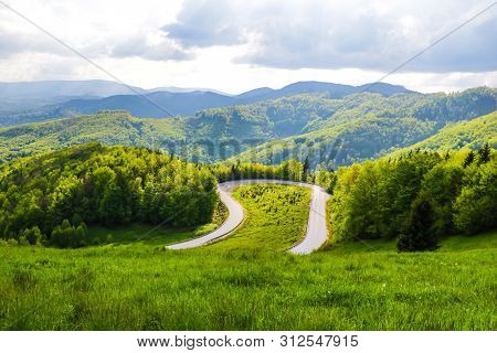 Mountain Winding Road In Slovakia, View From Above With A View Of The Mountains