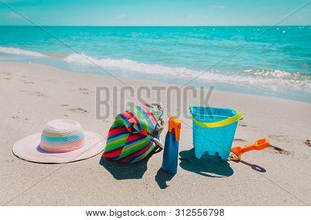 Hat, Bag , Suncream And Toys On Beach
