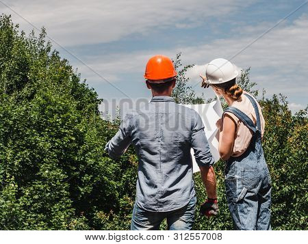 Young Engineer Woman And Her Subordinate Worker