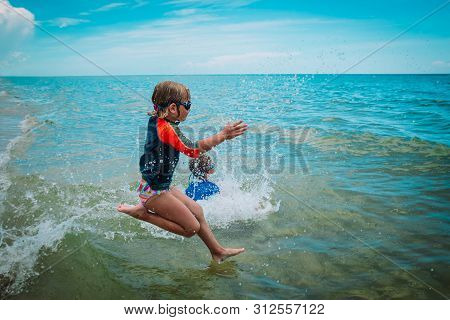 Kids- Girl And Boy- Run And Play With Waves On Beach