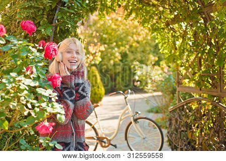 Favorite Music. Woman Headphones Blooming Garden. Weekend Activity. Active Leisure And Lifestyle. Gi